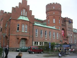 Castle-looking building in red bricks. Photo.